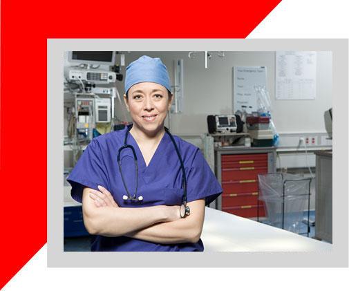 ICU doctor in scrubs behind ICU door